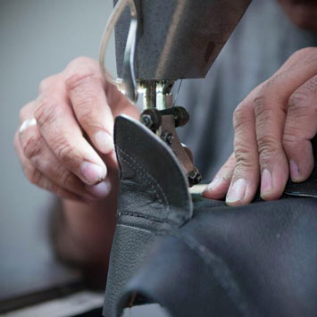 Man crafting leather shoes