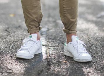 Man wearing white tennis shoes