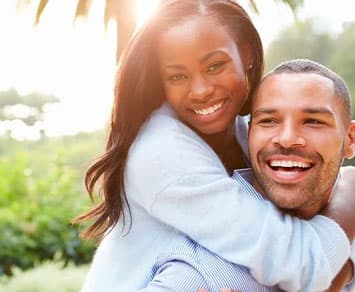 Smiling attractive black couple