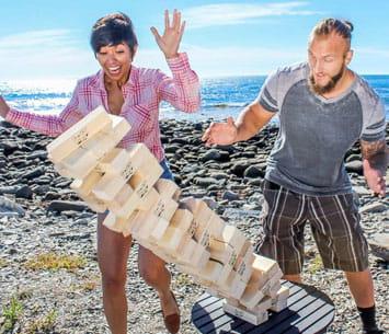 People playing Giant Jenga on beach