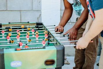 Men playing foosball
