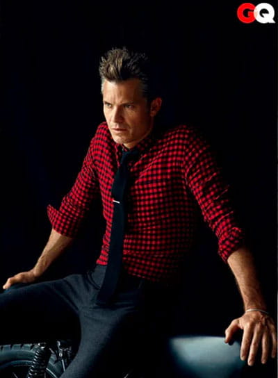 Timothy Olyphant wearing red plaid shirt