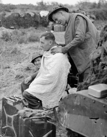 A soldier getting a taper fade haircut during WWII