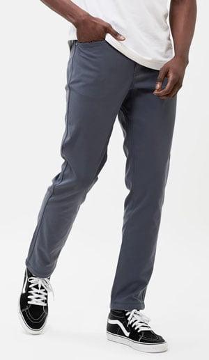Man wearing Western Rise AT Slim pants