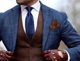 Blue suit, brown vest, brown pocket square