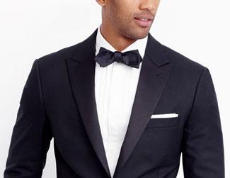 Man in tuxedo wearing white pocket square