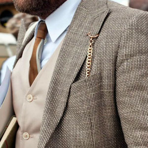 Man wearing pocket watch in front pocket of his suit