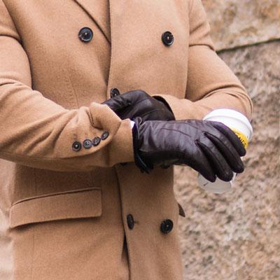 Man adjusting leather gloves