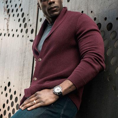 Man wearing burgundy shawl collar cardigan