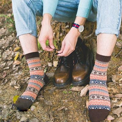 Man pulling on warm winter socks