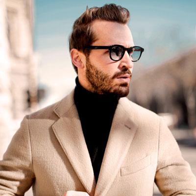 Man wearing black turtleneck under beige coat