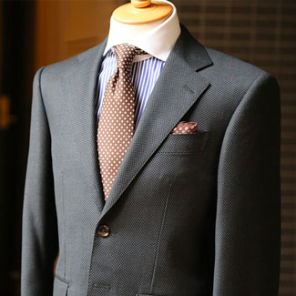 A nice grey suit displayed on a mannequin