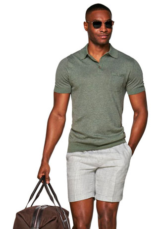 Man in green polo and grey shorts